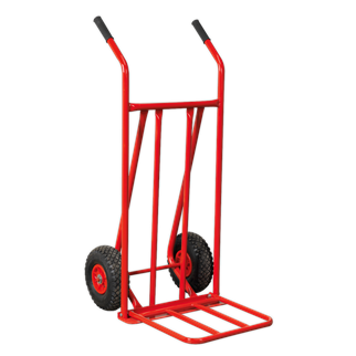 CST800 Sack Truck with Pneumatic Tyres & Foldable Toe 150kg Capacity • Manufactured from strong tubular steel with heavy-duty pneumatic tyres for transportation over rough terrain. • Features foldaway toe plate providing increased loading area. • Ideal for delivery drivers, farmers or builders. Product Image