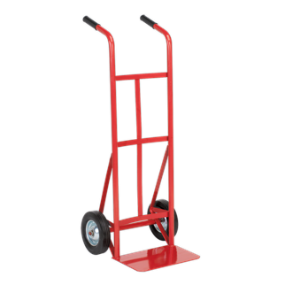 CST983 Sack Truck with Solid Tyres 150kg Capacity • Strong tubular steel construction with welded joints. • Heavy-duty wheels. • Features steel wheel inserts for added strength and durability. • Can be rested on handles for flat loading. • Fitted with rubber hand grips. Product Image